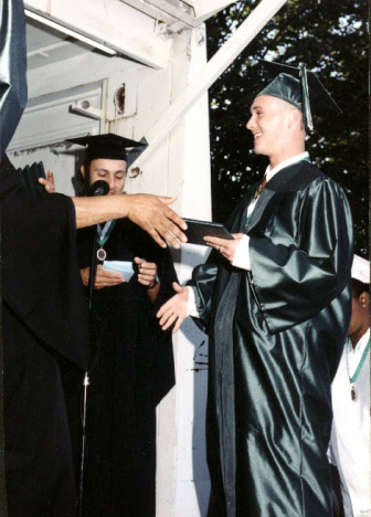 """Graduating from Norwalk High School, Ian had a huge smile for his mentor Mr. Amos who was handing him the diploma."" Published with permission from Ginger Katz, Courage to Speak, http://www.couragetospeak.org/"