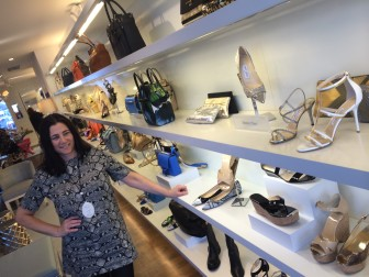 Lisa Mancini, assistant manager of Walin & Wolff on Elm Street, standing near the Jimmy Choo shoes. Credit: Michael Dinan
