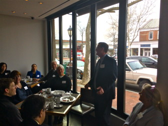 Yankee Gas Sales Manager Michael Collins addresses New Canaan businesspeople at the Chamber of Commerce's Breakfast with First Selectman Rob Mallozzi event. Credit (for shooting into the sun, sorry): Michael Dinan