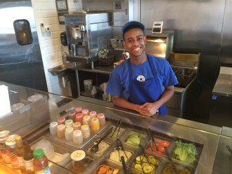 """Cesar Suero, line cook at Station Eats, says the cheeseburgers are popular and """"extra hot peppers"""" is a fairly common order. Credit: Michael Dinan"""