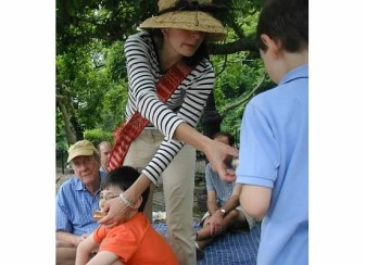 """Micaela Porta: """"Myself feeding both my kids (Victor 13, Lucas 8) simultaneously in Central Park during one of our thousands of picnics (we could picnic on the side of a road, possibly even a bathroom)."""" Contributed photo"""