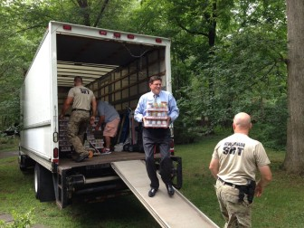 Volunteers assist with New Canaan-based Filling in the Blanks, a new nonprofit that's grown out of Blessings in a Backpack, operated locally by Shawnee Knight and Tina Kramer. This looks like New Canaan's own Tom O'Dea (R—125) with the police Special Response Team. Contributed photo