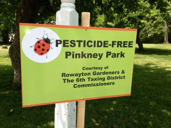 """Miki Porta: """"The Pinkney Park sign is from Rowayton, where they were able to make Pinkney Park an organic lawn demonstration site thanks to a presentation we gave to the Rowayton Gardeners. Because they'd invited important players from their town government to the talk, those people were able to push the button and make it happen."""" Contributed photo"""