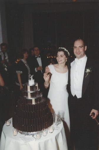 """""""The wedding picture is taken by our wedding cake, which Victor designed and made himself out of Yodels--553 of them, cut precisely according to his mathematically calculated plan. There weren't enough Yodels on the island of Manhattan to make this cake, so he had to go to an enormous supermarket in New Jersey off route 17 to get them.""""—Micaela Porta"""