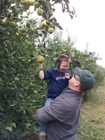 Andrew Blackwell apple-picking with dad Houston. Contributed photo