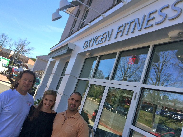 Oxygen Fitness owners Dave and Sara Koch (L) with their partner, Rich Fedeli. The trio, all New Canaan residents, will hit the one-year mark this month with their popular, full-service fitness center on Pine Street.