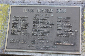 A plaque at God's Acre honors deceased military personnel. Credit: Terry Dinan