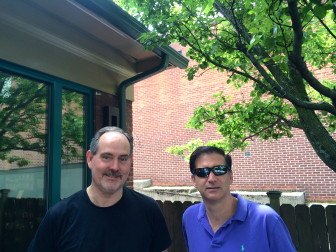 New Canaan residents Mark Collins (left) and John Rocco (right) enjoy coffees outside of Starbucks.