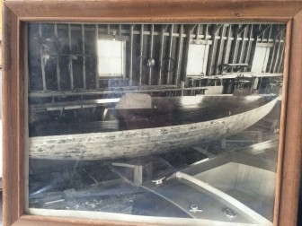 This photo of a boat being made by Thomas Throop's uncle, probably some time in the 1950s, is framed and placed in the office at Black Creek Designs.