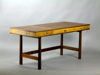 "This campaign desk, a piece of commissioned work, is made from a walnut tree up on Canoe Hill Road. The tree itself had special meaning for the owner, since his kids had played under it. Throop had the tree milled and dried and created this piece of furniture. ""You can't get any more special than that,"" he said."
