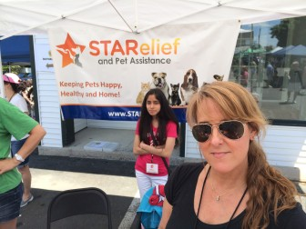 """Heather Scuitti is executive director of Stamford-based STARelief and Pet Assistance (""""Keeping Pets Happy, Healthy and Home""""), at the June 8, 2014 """"New Canaan Dog Days"""" on Cherry Street, presented by Village Critter Outfitter. Credit: Michael Dinan"""