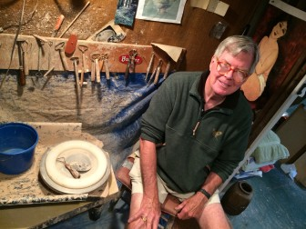 New Canaan resident George McEvoy, a retired marketer and active potter, in his workshop/studio on Seminary Street. Credit: Michael Dinan