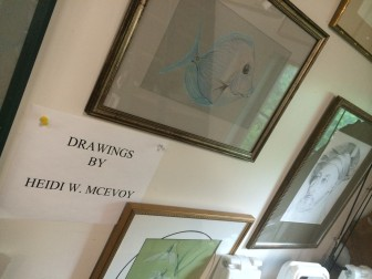 Heidi McEvoy's drawings adorn the walls at the pottery studio in New Canaan. Credit: Michael Dinan