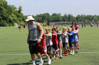Rams captain Zach Allen leads a conga line of campers. (Terry Dinan photo)
