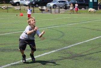 Sixth grader Will Besgen hauls in a pass. (Terry Dinan photo)