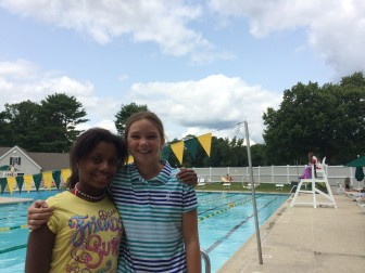 New friends Janaya(left) and Olivia(right) pose in front of the pool at the Country Club of New Canaan. Credit: Alex Hutchins