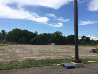 "New, ""post-tensioned concrete"" tennis courts are being installed at New Canaan High School, and a seventh court is finally being added. Here's a peek at the project on July 24, 2014. Credit: Michael Dinan"