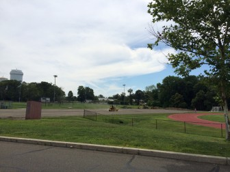 "New, ""post-tensioned concrete"" tennis courts are being installed at New Canaan High School, and a seventh court is finally being added. The 17-year-old courts that had been there are gone. Here's a peek at the project on July 24, 2014. Credit: Michael Dinan"