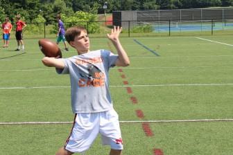 8th grader Will Rechtermann lofts a pass. (Terry Dinan photo)