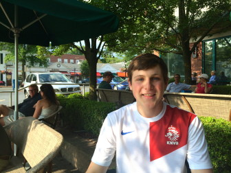 Rising senior Erik Burns sits down on a shady patio outside of Starbucks to talk about his experience with the college process. Credit: Alex Hutchins