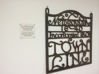 "This is hanging in the hallway at the temporary Town Hall offices located in the back of the Walter Stewart's building on Elm Street. From the plaque: ""One of the 18 Town Line Signs Forged by Clifton Meek at Silvermine Forge. Commissioned in 1936 by the Works Progress Administration Federal Art Project."" Credit: Michael Dinan"