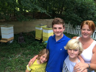 L-R: Sumner, Liam, Caleb and Michelle Orr stand near the family's beehives in New Canaan. Credit: Michael Dinan
