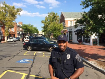 New Canaan Police Department Community Impact Officer Roy Adams on Elm Street. Credit: Michael Dinan