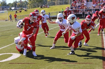 Harvard-bound NCHS Senior Co-Captain Alex LaPolice gave the Cardinals fits during the 35-20 Homecoming Weekend win at Dunning Stadium on Sept. 27, 2014. Credit: Terry Dinan