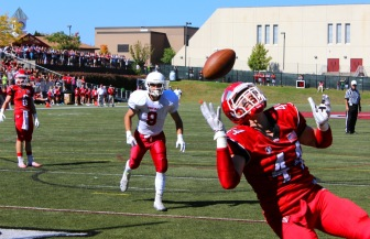 Senior co-captain Zach Allen attempts to reel in a pass in the end zone. Credit: Terry Dinan