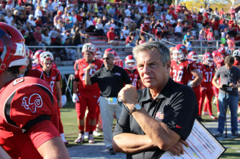 The 35-20 New Canaan Rams victory over Greenwich on Sept. 27, 2014 was the 300th in the illustrious career of head coach Lou Marinelli. Credit: Terry Dinan