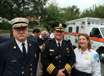 Fire Chief Jack Hennessey, Police Chief Leon Krolikowski and EMT Wendy Hilboldt of NCVAC after the Sept. 11, 2014 9/11 memorial ceremony at NCPD. Credit: Michael Dinan