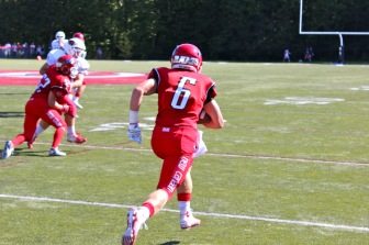 Michael Kraus returns an interception. Credit: Terry Dinan