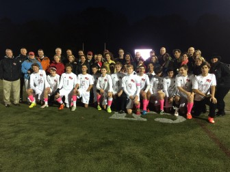 The varsity NCHS Rams Soccer Team players pose with their parents during Senior Night at Dunning Field, Oct. 22, 2014. Credit: Michael Dinan