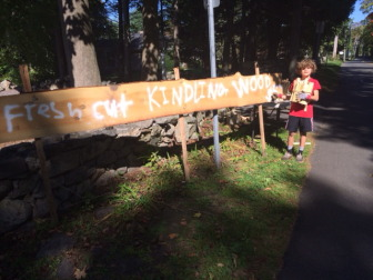 The kindling stand, its sign also re-used lumber from the project. Contributed photo
