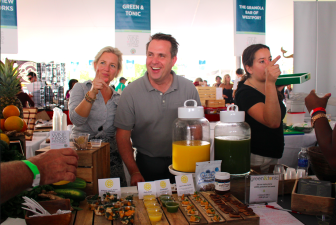 Jeffrey and Cai Pandolfino sampling healthy food and juices at the Culinary Village at the Wine + Food Festival last Saturday. Credit: Leslie Yager