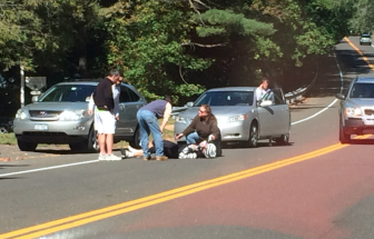 Motorists stop on Route 123 near the New Canaan Field Club where it appears that a cyclist went down on Sunday, Oct. 5. Contributed photo