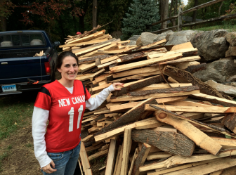 NCHS woodworking teacher Ashley O'Connor at the Larsons, picking out pieces for her students to use. Credit: Michael Dinan