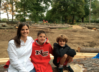 Kristina says her three sons (Gus and Will here) are all enjoying the barn restoration project going on at their home, opposite West School. Credit: Michael Dinan