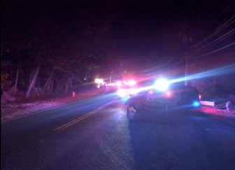 Emergency responders have blocked off Silvermine Road northbound at the Little Brook Road/Clapboard Hill intersection following a serious car accident at about 5:30 p.m. on Oct. 30, 2014. Credit: Michael Dinan
