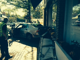 Officials look on where a motorist appears to have hopped the sidewalk at Main near Elm Street and Morse Court in reverse on Sunday Oct. 5. Contributed photo