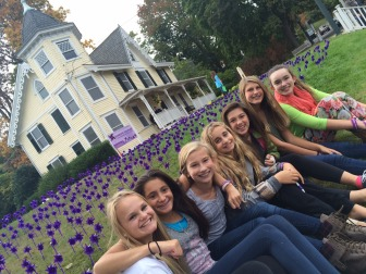 Members of the Canaan Parish Chapter of the National Charity League for their seventh grade project (they're all Saxe Middle School seventh-graders) inserted 1,000 pinwheels into the grass outside of Vine Cottage to mark October as Domestic Violence Awareness Month. Each pinwheel represents one resident who called New Canaan Police in the past 10 years because of violence in their homes. L-R: Fallon Arnone, Caroline Tuffy, Alex Carlson, Sadie Slattery, Emma Schullman, Ally Leopold and Paula Graham. Credit: Michael Dinan