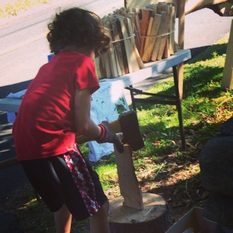 The youngest Larson brother chops kindling and sells it at a makeshift roadside stand opposite West School. Contributed photo