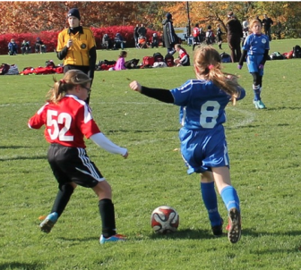 Tema Wagner battles for the ball during New Canaan's win against Old Greenwich on Sunday. Contributed photo