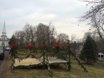 With a bandstand and new tree, God's Acre is ready for Christmas Eve carolers at 6:30 p.m. on Dec. 24, 2014. Credit: Michael Dinan