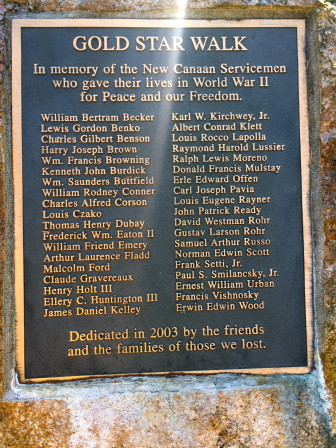 "This plaque stands by a footbridge at the northern edge of Mead Pond, part of the ""Gold Star Walk,"" a memorial to New Canaan's 38 servicemen lost during World War II. Credit: Michael Dinan"