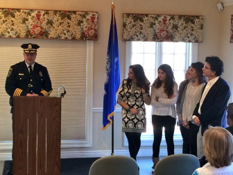 Police Chief Leon Krolikowski, with New Canaan's Taben family looking on, addresses a crowd during an Awards ceremony on Dec. 15, 2014. Credit: Michael Dinan