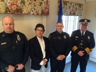 New Canaan Police Officer Michael O'Sullivan, resident Charles Taben, Officer Brian Micena and Chief Leon Krolikowski during an Awards ceremony on Dec. 15, 2014. Credit: Michael Dinan