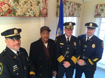 L-R: New Canaan Police Capt. VIncent DeMaio, honoree Terry Darden, Chief Leon Krolikowski and Capt. John DiFederico during an Awards ceremony on Dec. 15, 2014. Credit: Michael Dinan