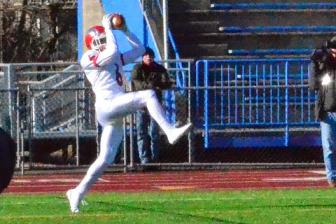New Canaan High School's Michael Kraus put the Rams on the board versus Darien in the CIAC Class L Large final on Dec. 13, 2014. Credit: Ronnie Roganti