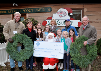 Front row with Santa: Taylor Lanxon, Nicole Ayoub, Julia Carpi, Madeleine Erns. Top row: Bob Clay, Cynthia Gorey, Sophie O'Neil, Macy Harrell, Arianna Bell, Dave Hunt, Laura Walbert and Kevin McIntosh. Contributed photo